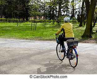 Young man riding on his bike In the park