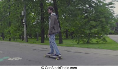 Young man riding on longboard