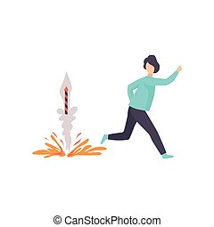 Young man running away from an exploding firework rocket,...