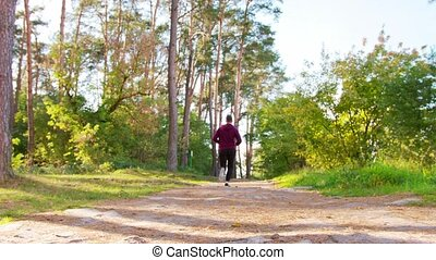 Young Man Running in the Forest