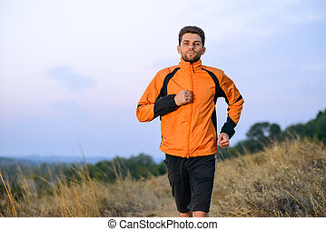 Young Man Running Outdoor on the Trail in the Park. Active Lifestyle