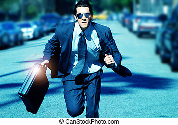 young man running with briefcase - young business man...