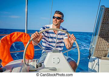 Young man sailing yacht steering wheel vacation sail...