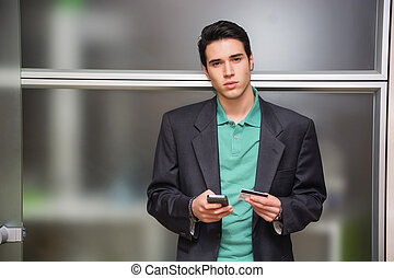 Young man shopping online on mobile phone