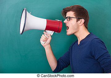 Young Man Shouting In Megaphone