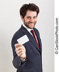 Young man showing a business card