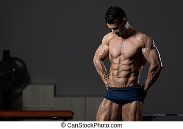 Young Man Showing Abdominal Muscle - Young Man Standing ...