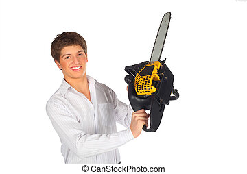 Young man shows chainsaw