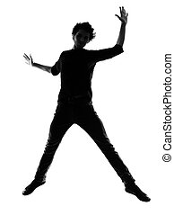 young man silhouette jumping happy