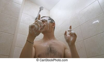 Young man singing in shower - Funny man singing in shower