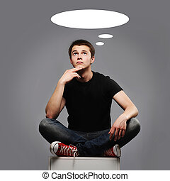 young man sitting and thinking about something