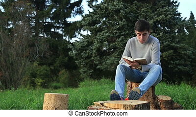 Young man sitting in a park