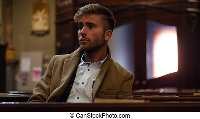 Young man sitting in church