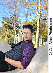 Young man sitting on a park
