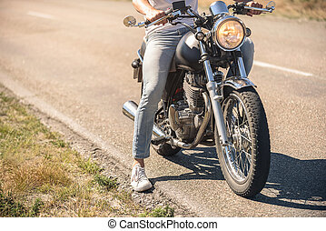 Young man sitting on his motorbike