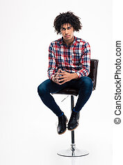 Young man sitting on the chair