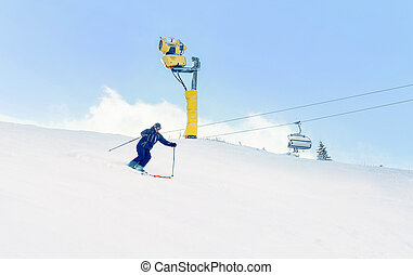 Young man sliding very fast while skiing on the mountain