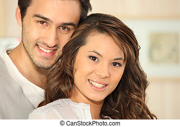 Young man smiling and Asian girl