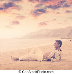 Young man smiling at beach