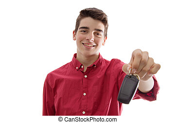 young man smiling isolated with car keys or remote control