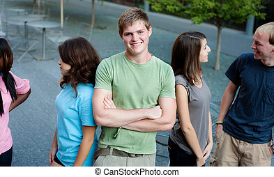 Young man smiling with friends