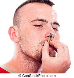 Young man smoking hashish