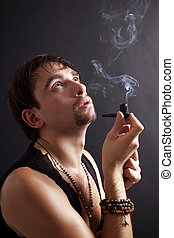 young man smoking  little pipe