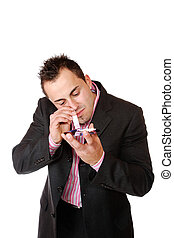 Young businessman sniffing cocaine on a CD/DVD