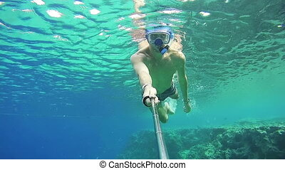 Young Man Snorkeling on Colorful Reef in Red Sea, Egypt