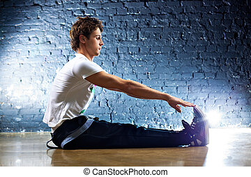 Young man sports exercises