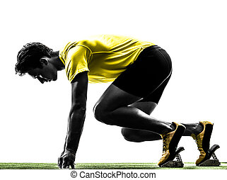 young man sprinter runner in starting blocks silhouette -...