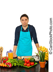 Young man standing in kitchen