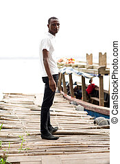 young man standing on a dock.