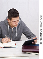 young man studying at home, lifestyle