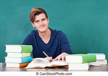 Young Man Studying In Classroom