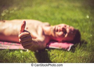 Young man sunbathing