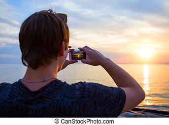 Young Man take a Photo
