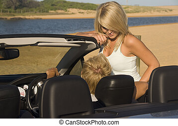 Young man taks with attractive blond at the beach