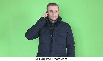young man talking at phone close up