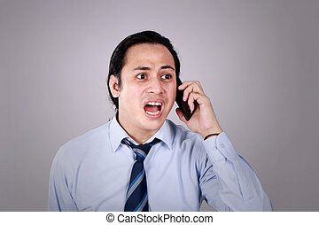 Young Man Talking on Phone, Shocked Worried Expression