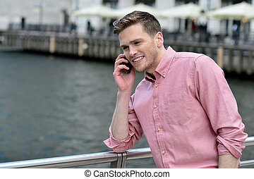 Young man talking on the cell phone