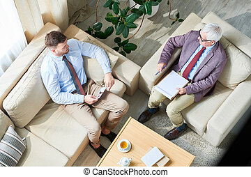Young man talking to psychiatrist about his relationship