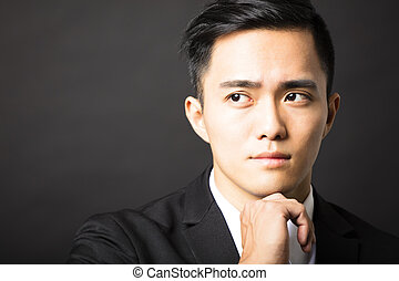 young man thinking and black background