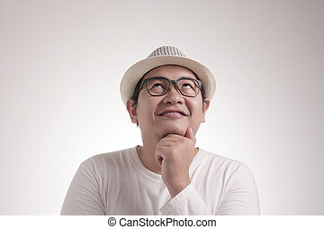 Young Man Thinking and Looking Up, Having Good Idea