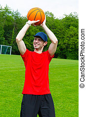 Young man throwing Basketball