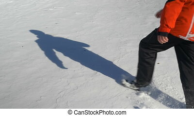 Young man throwing himself in the snow and making snow angels