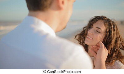 Young man touch face of his woman