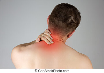 Young man touching his neck for the pain