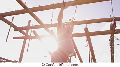 Young man training at an outdoor gym bootcamp