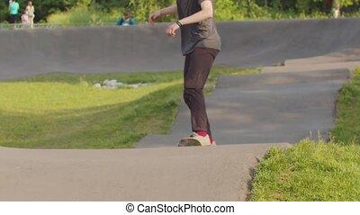 Young man training his skateboarding skills. Skating on the...
